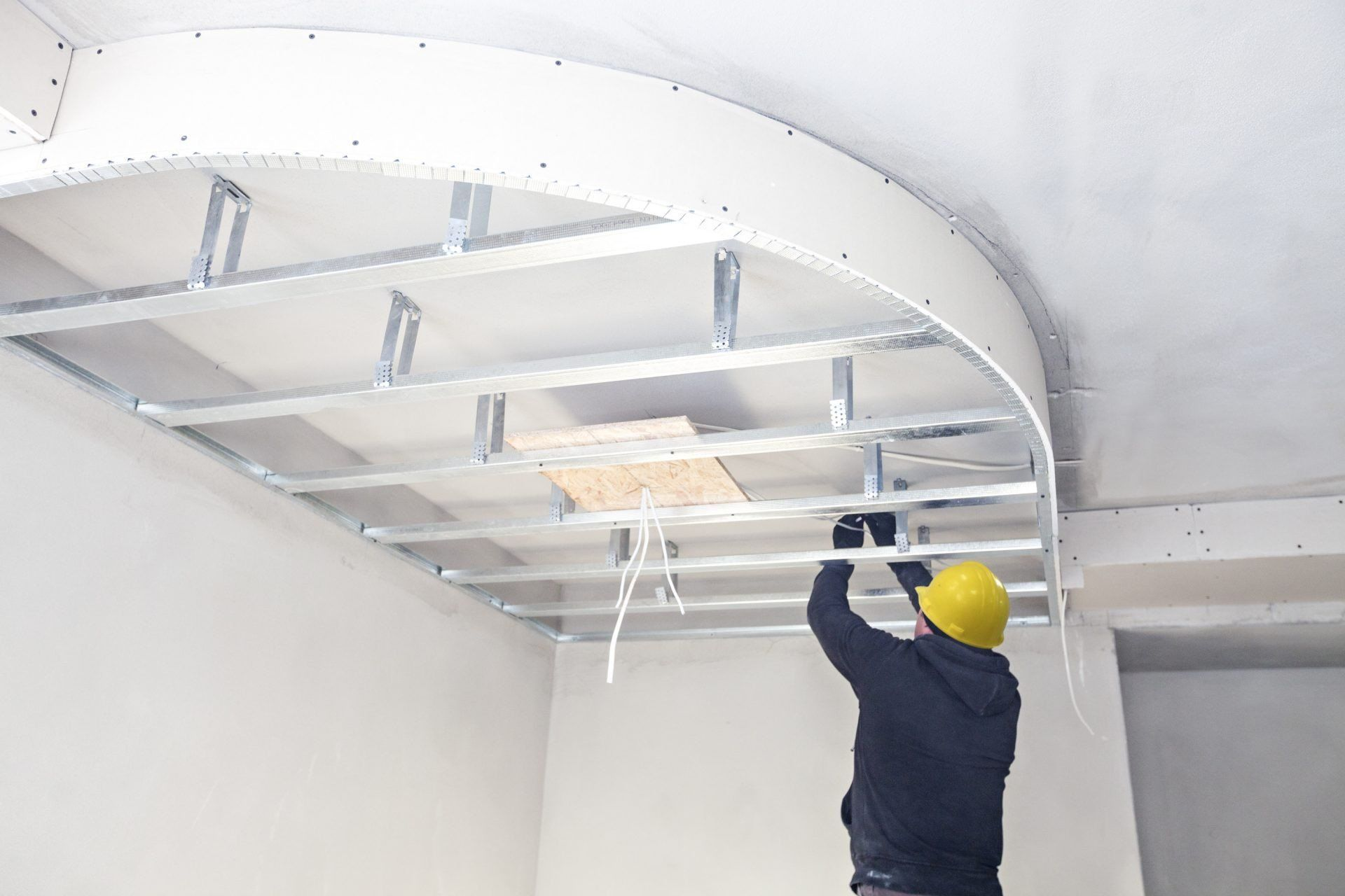 contractor working on a ceiling in a resturant out in hamilton ontario