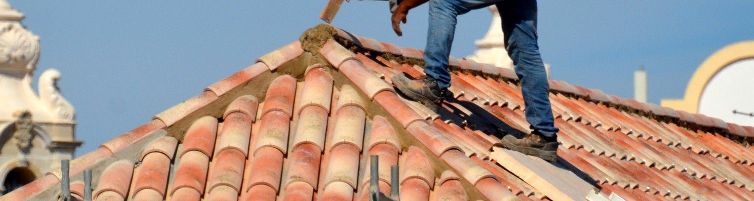 roofer working on a home in milton ontario